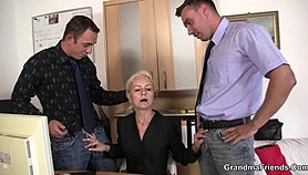 A granny gets convinced to fuck those two studs in the office